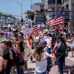 Protestors swarm the streets of Huntington Beach as some Californians are growing frustrated with the coronavirus lockdown