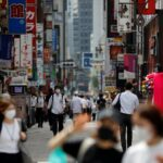 Japan's Abe faces anger over tourism subsidy as Tokyo COVID-19 cases hit record