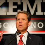 Georgia Gov. Brian Kemp sues Atlanta's mayor to stop her from requiring masks as COVID-19 cases skyrocket