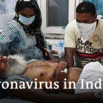 India COVID cases pass 2 million after record daily jump | DW India