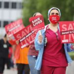 Hospital staff members say they can't get coronavirus tests, are forced to reuse PPE